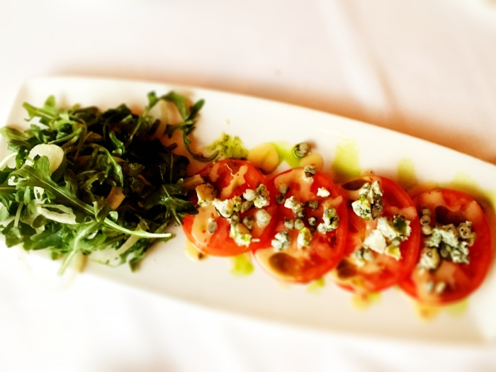 Kamuela-vine-ripened-tomatos-with-Point-Reyes-Bleu-Cheese-crispy-capers-and-Baby-arugula-and-fennel-in-chili-citrus-vinaigrette.jpg